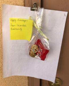 picture of mini-treat bags with hand written holiday greetings that had been prepared by the resident council for the whole community