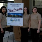 Mutual Housing staff members prepare to welcome guests to the Grand Opening of New Harmony Mutual Housing.