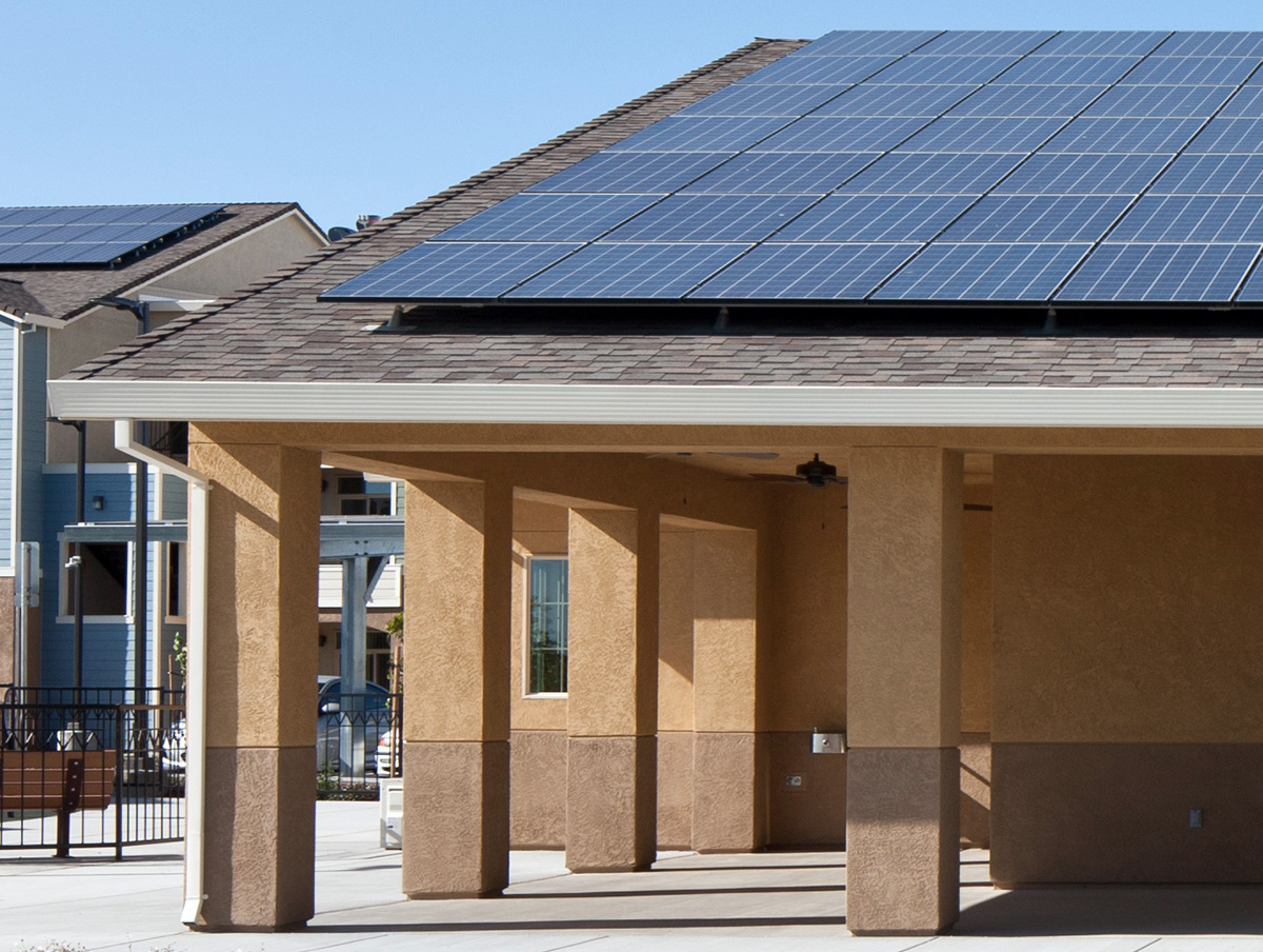 an image of a school building with large solar panels on top of it